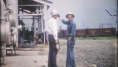 166 - oil refinery workers walk the grounds - vintage film home movie Stock Footage