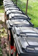 trash bins for separate waste collection of municipal solid waste in the city - stock photo