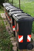 trash bins for separate waste collection of solid waste 1 - stock photo