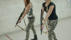 2 Girls Aiming AKS-74U - 001 Stock Footage