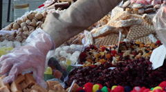 Buying sweets market, local food, candies, sweetmeats, cookies, candy gum - stock footage
