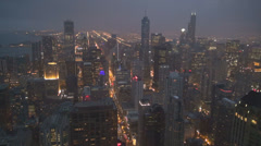 Aerial view Chicago building downtown cityscape skyline road traffic car dusk US Stock Footage