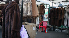 Selling natural fur coats, clothes made from animal furry, winter fur hats Stock Footage