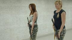 2 Girls Aiming AKS-74U - 003 Stock Footage