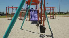 Childrens playground swing, australia Stock Footage