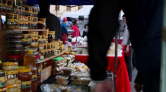 Selling honey products at local market, street vendor, pollen, honeycomb, soap Stock Footage