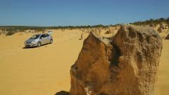 Tourists in cars drive round the pinnacles, nambung national park, Australia Stock Footage