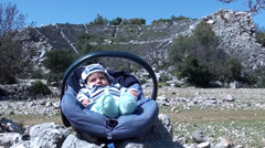 Baby in chair and amphitheater Stock Footage