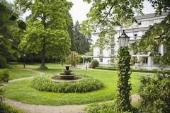 English garden with hotel in the background Stock Photos