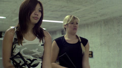 Blonde & Asian Girl Aiming AKS-74U - 002 - Slow motion Stock Footage