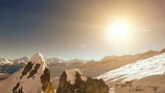 Stock Video Footage of snowcapped mountains. aerial view. fly over. sunset