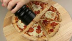 Grinding Pepper On To Pizza Stock Footage