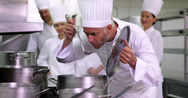 Stock Video Footage of Head chef tasting pot of soup making ok sign