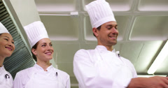 Stock Video Footage of Chef showing colleagues contents of large pot low angle view