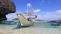 Tourist boats in lagoon.  El Nido, island Palawan, Philippines. Stock Footage