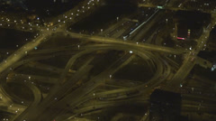 Aerial view illuminated freeway highway panorama interchange night car pass line Stock Footage