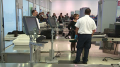 Airport security screening for weapons at Toronto Pearson airport Stock Footage