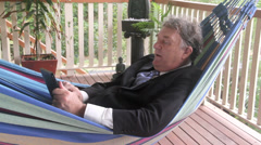 Businessman Swinging Working In Hammock Stock Footage
