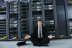 business man practice yoga at network server room - stock photo
