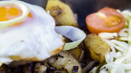 Stock Video Footage of Tiroler grostlle with cabbage salad and egg