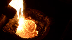 Side view of molten chromium at a smelter Stock Footage