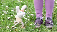 White rabbit marionette dancing on green grass Stock Footage