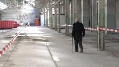 Older man walking in old building Stock Footage