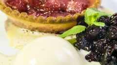 Freshly baked rhubarb tartlet with honey ice cream and cherry coulis Stock Footage