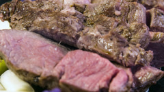 Lamb picanha served with vitelotte puree,poached white and green asparagus Stock Footage