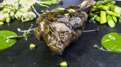 Lamb shank with domestic spinach gnocchi,green asparagus and wild garlic cream Stock Footage