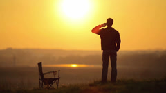4K & HD resolution - The man stands & phones by sunset backg-nd,RAW video output Stock Footage