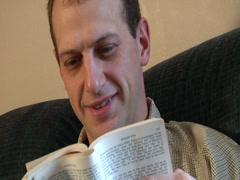 CU reading a book Stock Footage