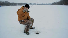Ice Fishing WS Jigging Stock Footage