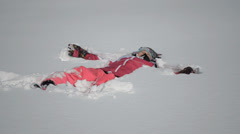 Making a snow angel Stock Footage
