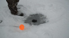 Ice Fishing Setting up Tip Up Stock Footage