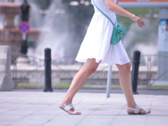 naked legs young adult women walking street - stock footage