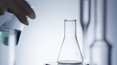 Pouring Reagents into Flask Laboratory - stock footage