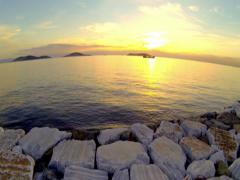 Take off and fly over Marmara Sea towards Princes Islands at sunset 2K Stock Footage