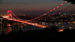 Time lapse blue time traffic on the bridge at night, tracking shot Stock Footage