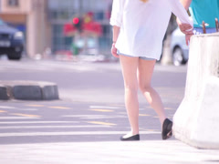 attractive beautiful naked legs young adult women crossing zebra - stock footage
