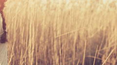 Happy Woman Standing in Nature Sunset Colors Dry Cane UHD 4K Stock Footage