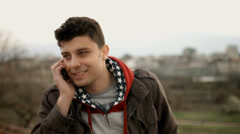 Young Man Smiling Talking on Cellphone UHD 4K Stock Footage