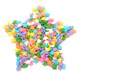 Stock Photo of multi colors stars candy forming star shape