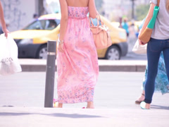 superb pink dress young adult woman crossing zebra - stock footage