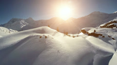Fly over snowcapped winter landscape. snow covered mountains. aerial view Stock Footage