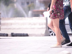 Walking flowery short dress nice naked legs young adult woman Stock Footage