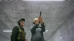 Blonde Girl Firing Colt 45 - 001 Stock Footage