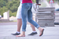 walking superb red shirt bluejeans long legs young adult woman - stock footage