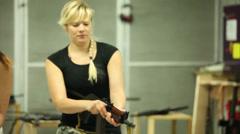 Blonde Girl Running Aiming AKS-74U - 002 Stock Footage