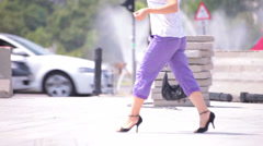violet trousers young adult woman walking crossing street - stock footage
